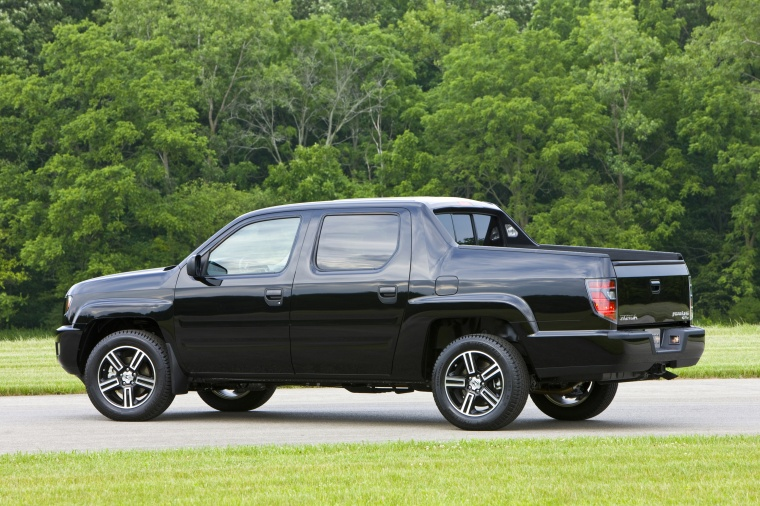 2013 Honda Ridgeline in Crystal Black Pearl from a rear left three-quarter view