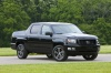 2013 Honda Ridgeline in Crystal Black Pearl from a front right three-quarter view