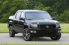 2013 Honda Ridgeline in Crystal Black Pearl from a front right view