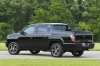 2013 Honda Ridgeline in Crystal Black Pearl from a rear left view