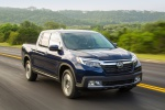 2019 Honda Ridgeline AWD in Obsidian Blue Pearl - Driving Front Right View