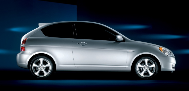 2010 Hyundai Accent Hatchback in Platinum Silver Pearl from a side view