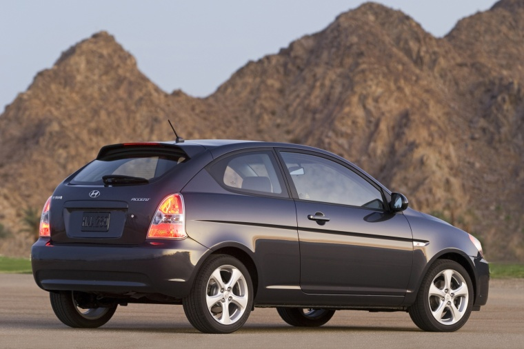 2010 Hyundai Accent Hatchback in Ebony Black from a rear right three-quarter view
