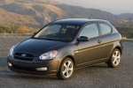 2010 Hyundai Accent Hatchback in Ebony Black - Static Front Left Three-quarter View
