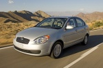 2010 Hyundai Accent Hatchback in Platinum Silver Pearl - Driving Front Left Three-quarter View