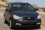 2010 Hyundai Accent Hatchback in Ebony Black - Static Front Right View