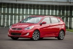 2015 Hyundai Accent Hatchback in Boston Red Metallic - Static Front Left Three-quarter View