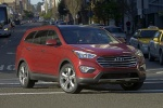 2013 Hyundai Santa Fe in Regal Red Pearl - Driving Front Right View