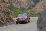 2013 Hyundai Santa Fe Sport in Serrano Red - Driving Front Left View