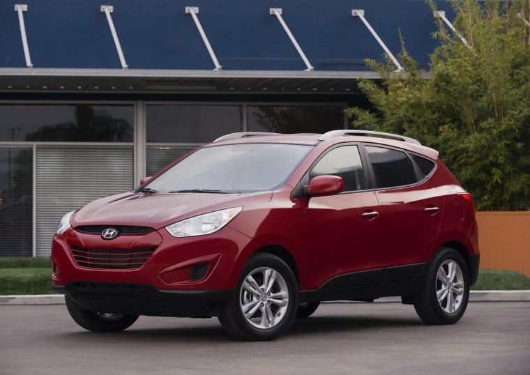 2010 Hyundai Tucson AWD in Garnet Red from a front left view