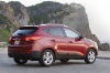2010 Hyundai Tucson AWD in Garnet Red from a rear right three-quarter view