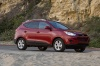 2010 Hyundai Tucson AWD in Garnet Red from a front right view