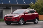 2011 Hyundai Tucson AWD in Garnet Red - Static Front Left View