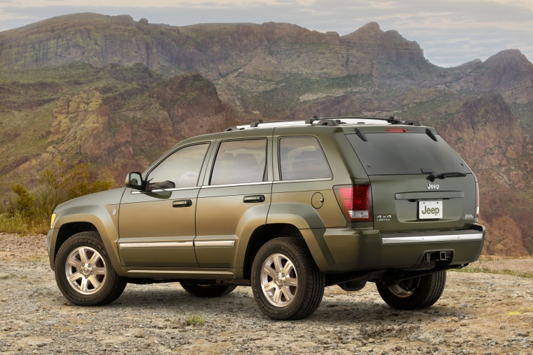 2010 Jeep Grand Cherokee in color from a rear left three-quarter view