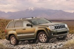 2010 Jeep Grand Cherokee in color - Static Front Right Three-quarter View