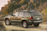 2010 Jeep Grand Cherokee in color - Static Rear Left Three-quarter View