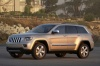 2011 Jeep Grand Cherokee Limited 4WD in White Gold Clearcoat from a front left three-quarter view