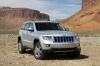 2013 Jeep Grand Cherokee in Bright Silver Metallic Clearcoat from a front right view
