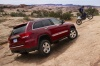 2013 Jeep Grand Cherokee Limited 4WD in Deep Cherry Red Crystal Pearlcoat from a rear right three-quarter view
