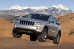 2013 Jeep Grand Cherokee in Bright Silver Metallic Clearcoat - Static Front Left Three-quarter View