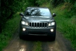 2013 Jeep Grand Cherokee in Bright Silver Metallic Clearcoat - Driving Frontal View
