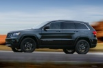 2013 Jeep Grand Cherokee Overland 4WD in Brilliant Black Crystal Pearlcoat - Driving Left Side View