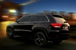 2013 Jeep Grand Cherokee Overland 4WD in Brilliant Black Crystal Pearlcoat - Driving Rear Left Three-quarter View