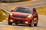 2018 Kia Niro Touring Hybrid in Crimson Red - Driving Front Left View