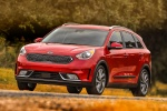 2018 Kia Niro Touring Hybrid in Crimson Red - Driving Front Left Three-quarter View