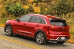 2018 Kia Niro Touring Hybrid in Crimson Red - Driving Rear Left Three-quarter View