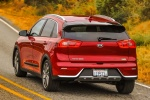 2018 Kia Niro Touring Hybrid in Crimson Red - Driving Rear Left View