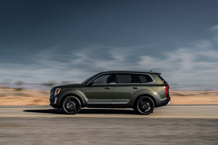 Driving 2020 Kia Telluride AWD in Dark Moss from a side view