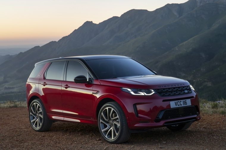 2020 Land Rover Discovery Sport P290 HSE R-Dynamic in Firenze Red Metallic from a front right three-quarter view