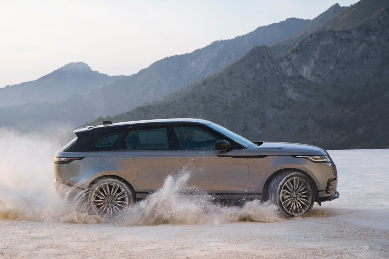 Driving 2019 Land Rover Range Rover Velar P380 HSE R-Dynamic in Silicon Silver Premium Metallic from a side view