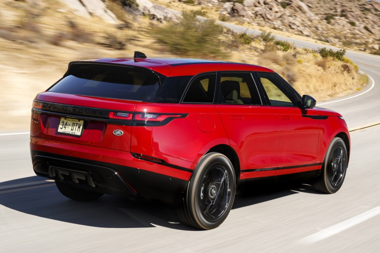 Driving 2019 Land Rover Range Rover Velar P250 SE R-Dynamic in Firenze Red Metallic from a rear right three-quarter view