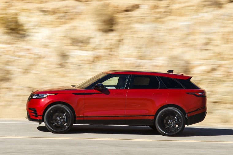Driving 2019 Land Rover Range Rover Velar P250 SE R-Dynamic in Firenze Red Metallic from a left side view