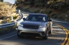 Driving 2019 Land Rover Range Rover Velar P380 HSE R-Dynamic in Silicon Silver Premium Metallic from a frontal view