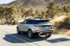 Driving 2019 Land Rover Range Rover Velar P380 HSE R-Dynamic in Silicon Silver Premium Metallic from a rear left view
