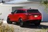 2019 Land Rover Range Rover Velar P250 SE R-Dynamic in Firenze Red Metallic from a rear left view