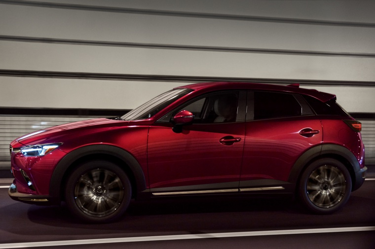 Driving 2020 Mazda CX-3 Sport in Soul Red Crystal Metallic from a side view
