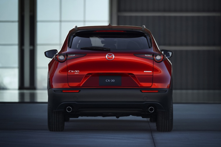 2020 Mazda CX-30 Premium Package AWD in Soul Red Crystal Metallic from a rear view