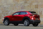 2020 Mazda CX-30 Premium Package AWD in Soul Red Crystal Metallic - Static Rear Left Three-quarter View