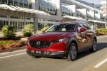 2020 Mazda CX-30 Premium Package AWD in Soul Red Crystal Metallic - Driving Front Left View