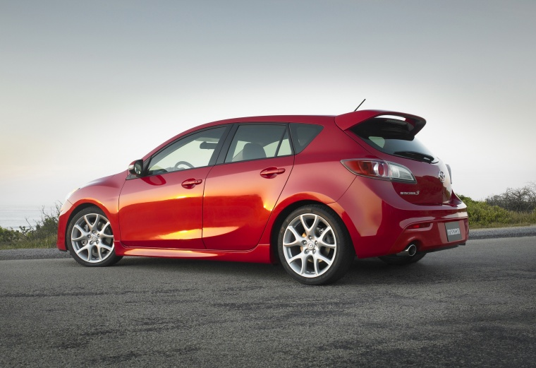 2010 Mazdaspeed3 in Velocity Red Mica from a rear left three-quarter view