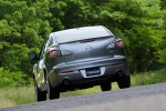 2010 Mazda 3s Sedan in Liquid Silver Metallic - Driving Rear View