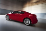 2010 Nissan Altima Coupe 3.5 SR in Red Alert - Driving Rear Left Three-quarter View