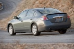 2010 Nissan Altima Hybrid in Dark Slate Metallic - Driving Rear Left Three-quarter View