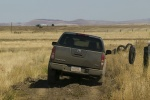 2010 Nissan Frontier Crew Cab PRO-4X 4WD in Night Armor - Driving Rear View