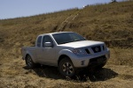 2010 Nissan Frontier King Cab PRO-4X 4WD in Radiant Silver - Driving Front Right Three-quarter View