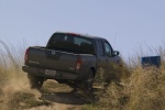 2013 Nissan Frontier Crew Cab PRO-4X 4WD in Night Armor - Driving Rear Right View